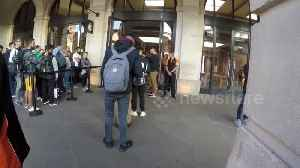 Customers depart Apple stores in London with new iPhones in hand [Video]