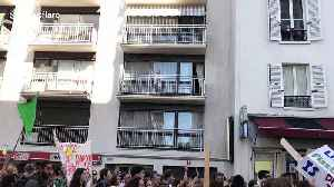 Elderly woman blows kisses to climate strikers marching below her balcony [Video]