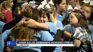 Cheer squad honors murdered friend at football game [Video]