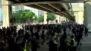 Hong Kong police fire tear gas and arrest protesters [Video]