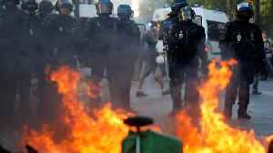 Paris police fire tear gas and arrest over 100 as protest turns violent [Video]