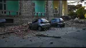 Destroyed cars lie next to damaged building after earthquake hits Tirana, Albania [Video]