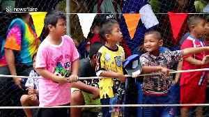 Bizarre race in Thailand where boys make a human boat and run through muddy field [Video]