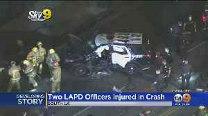 2 LAPD Officers Injured In South LA Rollover Crash [Video]