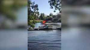 Boat engulfed in flames on River Thames [Video]