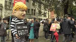 Man in Boris Johnson head and prison uniform declares him 'guilty' [Video]