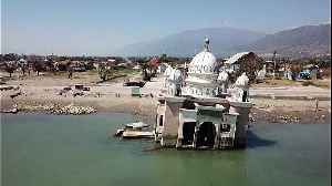 Drone images show damage one year after Indonesia earthquake, tsunami [Video]