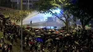 After peaceful protests, Hong Kong police fire water cannon [Video]