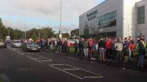 Laid-off Wrightbus workers demonstrate outside church [Video]
