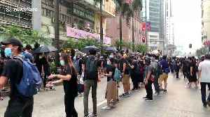 Resourceful Hong Kong activists form human chain to pass supplies to the front line of protest [Video]