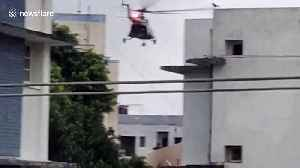 News video: Helicopters drop food packets on rooftop of flood-hit areas in northern India