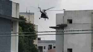 Helicopters drop food packets on rooftop of flood-hit areas in northern India [Video]