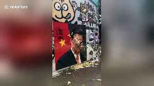 Hong Kong protesters THROW EGGS at portrait of Chinese President Xi Jinping [Video]