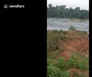 Dramatic moment river changes course and plunges into huge coal mine in India [Video]