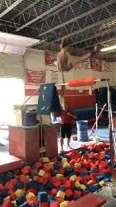 Girl Trying New Gymnastic Move Awkwardly Backflips into Foam Pit [Video]