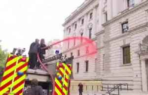 News video: Climate change activists spray red paint at UK Treasury from fire engine