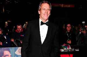 Hugh Laurie doesn't enjoy walking the red carpet [Video]