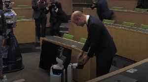 Robot gives Duke of Cambridge gift at Oxford University [Video]