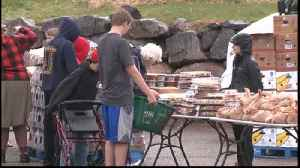 Local high school students lend a hand at mobile food pantry [Video]