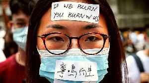 Hong Kong moves to ban face masks as protests continue [Video]