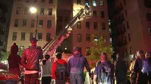 10 injured, including 9 firefighters, in New York City apartment fire [Video]