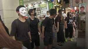 Hong Kong protesters defy mask ban [Video]