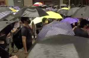 Umbrella movement? Defiant Hong Kong protesters march in the rain [Video]