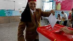 News video: Tunisians vote in unpredictable parliamentary elections
