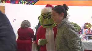 VIDEO: Grinch brings holiday cheer to sick children [Video]