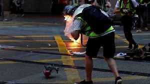 Journalist hit by petrol bomb as Hong Kong protesters defy emergency law [Video]
