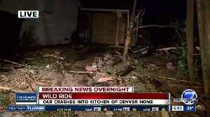 Car crashes through 2 fences, into home in Denver [Video]