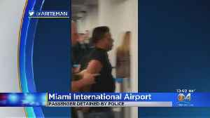 Man Detained At MIA After Forcing His Way Onto Flight [Video]