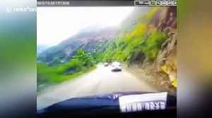 Huge boulder smashes car after tumbling down mountain in China [Video]