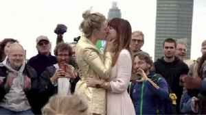 News video: Couple Stages Wedding on Westminster Bridge Amid Climate Protests in London