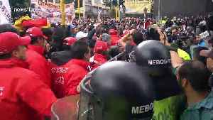 Supporters and opponents of Former Colombian president face off outside court in Bogota [Video]