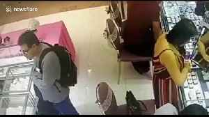 Man steals woman's handbag while she shops for jewellery in Malaysia [Video]