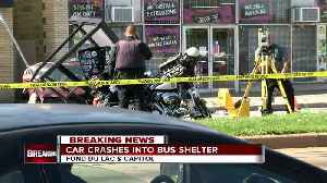 Car crashes into bus shelter [Video]