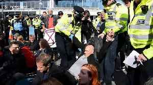 Extinction Rebellion protesters arrested as roof invader removed by police at London City Airport [Video]