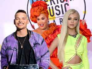 Kane Brown, PatrickStarrr, & More Talk Halloween Costumes & DMing Cardi B at the AMAs [Video]
