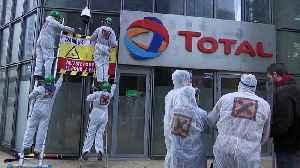 Activists spray paint Paris building of energy firm Total [Video]
