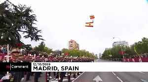 News video: Parachutist left dangling during Spain's National Day parade