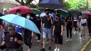 Hong Kong 'silver-haired' sit-in, masked protesters rally against emergency laws [Video]