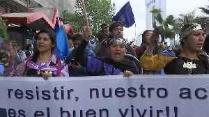 Indigenous groups in Chile stage rights march [Video]