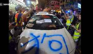 'Undercover Hong Kong police car' discovered by protesters and gets vandalised [Video]