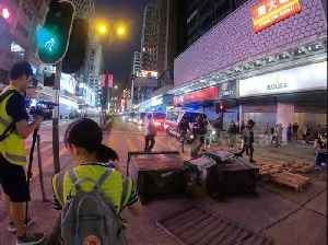 News video: Hong Kong riot police clear barricade as tensions remain high in another weekend of protests