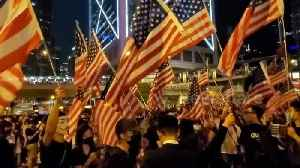 Thousands of pro-democracy protesters throng Hong Kong's Chater Garden waving US flags [Video]