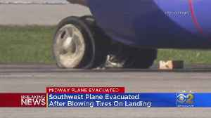 Southwest Flight Blows Tires After Landing At Midway [Video]