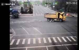 Chinese motorcyclist avoids serious injury after running red light and being dragged under truck [Video]