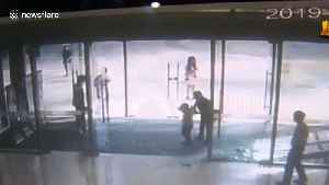 Glass door shatters on boy after he gives it a shove at mall in China [Video]
