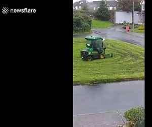 Man operating Galway council mower tears up grass field while cutting it on rainy day [Video]